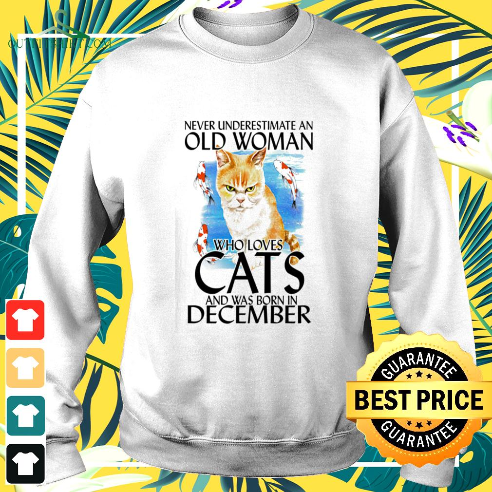 Never underestimate an old woman who loves cats and was born in December sweater
