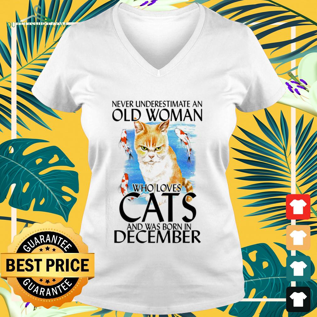 Never underestimate an old woman who loves cats and was born in December v-neck t-shirt
