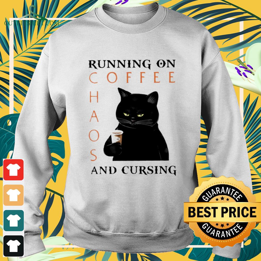 Black cat running on coffee chaos and cursing sweater